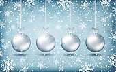 Four christmas balls with ribons