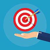Hand with target and arrow. Business concept