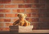 Fairy tale teddy bear and old books