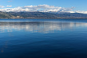 Panoramic Landscape of Lake Pamvotida, Pindus mountain and city of Ioannina, Greece