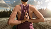 Young man practicing outdoors yoga