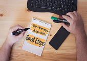Big Journeys Begin With Small Steps, on notebook