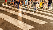 Pedestrians crossing at intersection at night