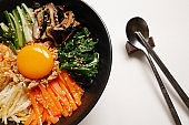 bibimbap ,korean rice mixed with meat and vegetables and egg yolk on top,traditional korean food