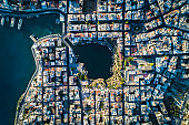 Aerial top view of streets, buildings and lake in Agios Nikolaos Crete, Greece