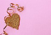 Valentine's Day pink paper background, gold heart