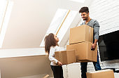 Man and his daughter moving into their new home