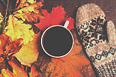 Autumn Fall Background  with leaves and cup of black coffee - Autumn Card for your design, top view with copy space