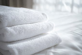 sun lights to the clean white towels on the hotel bed : feels cozy, comfort and relax