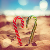 Christmas candy canes on the beach