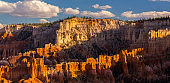 Scenery in Bryce Canyon National Park, under warm sunrise light
