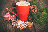 Christmas cappuccino and gingerbread cookies infront Christmas tree