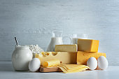 Set of fresh dairy products on light wooden background