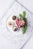 Luxury chocolates candy, christmas tree branch and christmas bear on a light background. Top view, free space