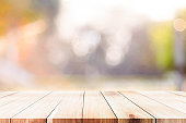 Wood table top on bokeh abstract background.