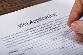 Person Filling Visa Application Form