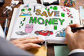 Businessperson Drawing Save Money Concept On Diary