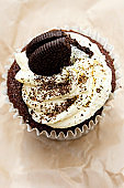 Chocolate cupcake with frosting and cream filled cookie