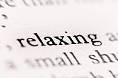 In an otherwise defocused document  the word 'relaxing' is sharp