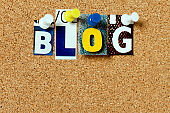 Corkboard with word 'Blog' in cut-out letters, copy space beneath
