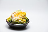 Cabbage for kimchi isolated on crock head