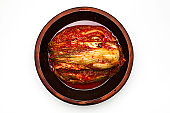Kimchi in a crock head isolated on white background