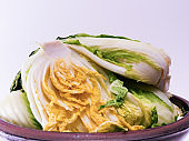 Salted cabbage on a traditional crock for making kimchi
