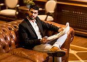 Modern businessman reading newspaper
