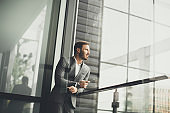 Young successful men entrepreneur using mobile phone outdoor