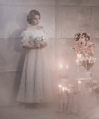 Portrait Of Lovely Young Woman With Wedding Bouquet