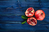 Pomegranate. Fresh fruits. On a wooden background. Top view. Free space for text.