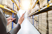 Female manager working at modern warehouse