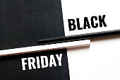 black friday, monochrome concept with paper sheets and pencils