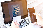 hand used credit card and smartphone for online payment