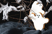 Sweet Halloween. Cookies in the form of ghosts. Dark background. Space for text.