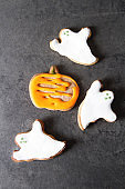 Sweet Halloween. Cookies in the form of ghosts, leaves and pumpkins. Dark background. Space for text.