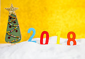 Christmas tree design on blurred gold background