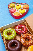 Glazed donuts and macaroons. Sweet dessert.