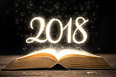 Glowing new year 2018 with magic book