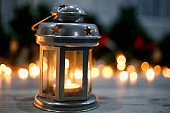 Christmas Lantern on Wooden Floor with Pine Branches