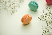 Dessert. Sweet macarons or macaroons with flowers.