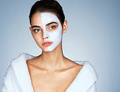 Gorgeous woman with cosmetic mask on her face