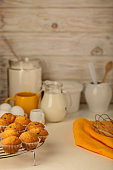 Kitchen utensils, tools and products for the capcake (muffins) on a light wooden background.