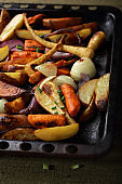 Roasted vegetables mix on tray, food closeup