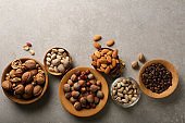 Mixed nuts on stone background