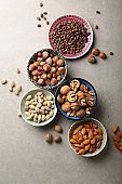 Various nuts in bowls, food above