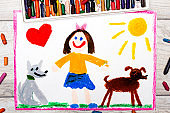 Photo of colorful drawing: Smiling little girl and her cute dogs