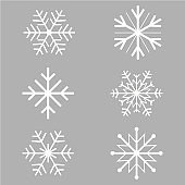 Snowflakes on the grey background