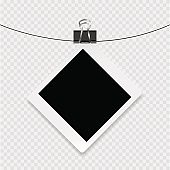 Photoframe with white contour and clip on a transparent background