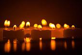 candle dark bokeh background